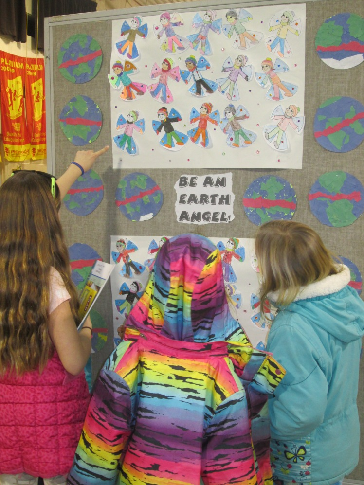 Tom Thomson students viewing the art on display