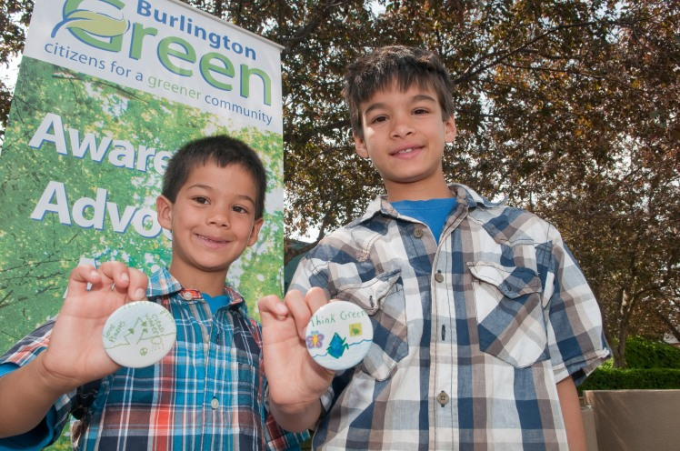 Adam and Sami proudly displaying their eco-pledge buttons.