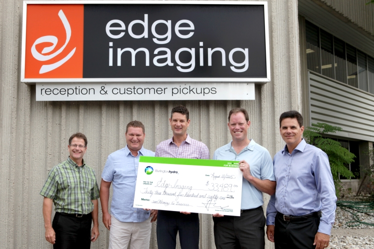 Burlington Hydro Inc. presenting Edge Imaging with an incentive cheque through the saveONenergy for Business Retrofit Program.