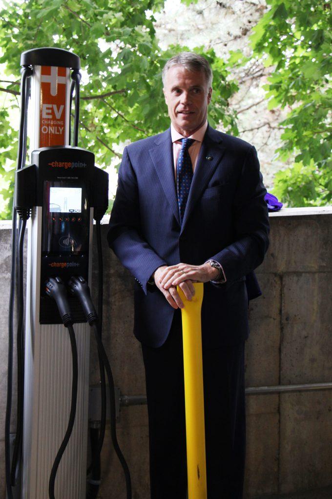 Mayor Rick Goldring unveils the City of Burlington's EV charging station at 414 Locust St.