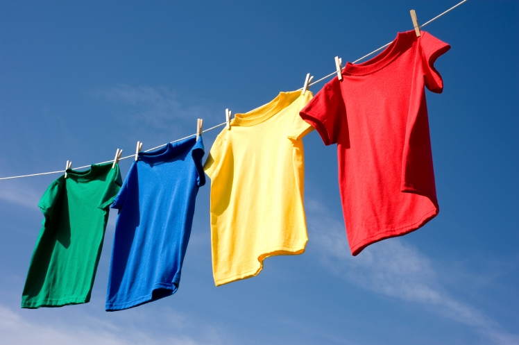 Hanging laundry to dry outdoors.