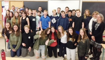 Mr. Papadopoulos, Grade 9 geography students and guests pose for a photo.