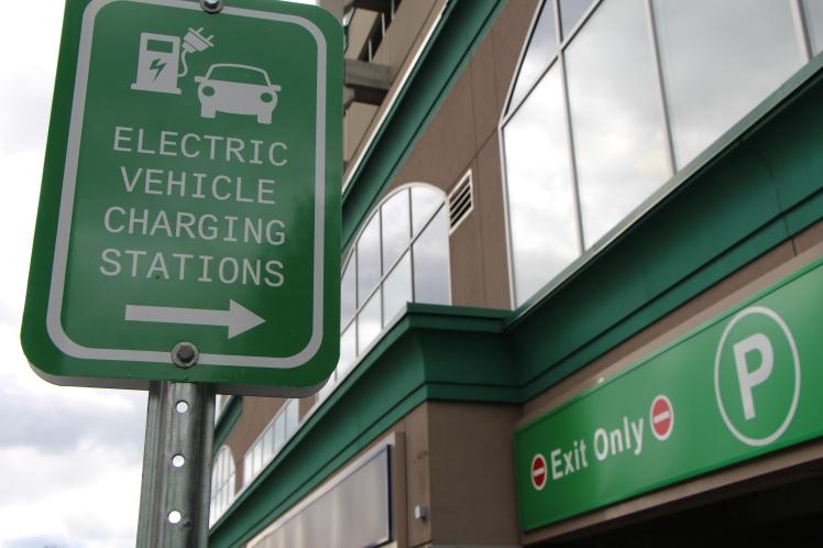 EV charging stations signage at the entrance to Burlington's parking garage at 414 Locust St.