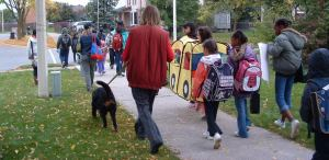 students and adults walking to school together
